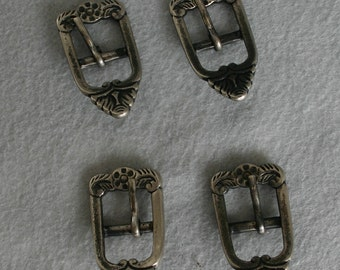 Set of  Four Silver Buckles