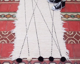 how to clean a pom pom rug