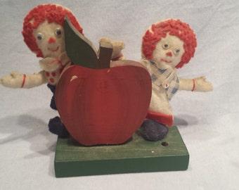 Handmade Raggedy Ann & Andy behind Apple Pen holder