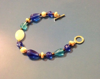 Toggle close blue beaded bracelet