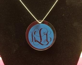 "Monogrammed 2"" round acrylic pendant."