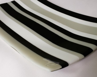In the black. Fused glass platter or tray.
