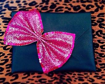 Black and pink embellished bag