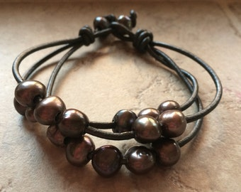 Leather and brown pearl bracelet.