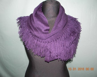 Handmade knitted snood with tassels.