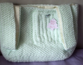 Babys hand knitted nappy bag
