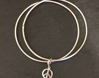 Two Sterling Silver Stacking Bracelets with a Peace Charm