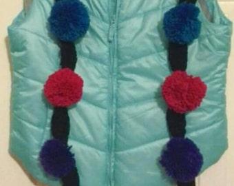 Colored pom pom scarf