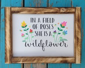 In a field of roses she is a wildflower - wood sign - hand lettered - hand painted - rustic wood sign - girls room decor - home decor