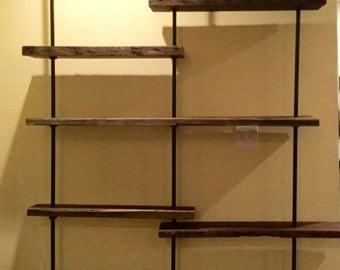 Reclaimed wood pipe shelves