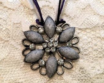 Rhinestone-Embellished Grey Flower Pendant