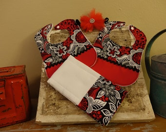 Red, black, and white bib and burp cloth set with matching headband