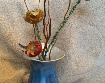 Gourd flowers and vase