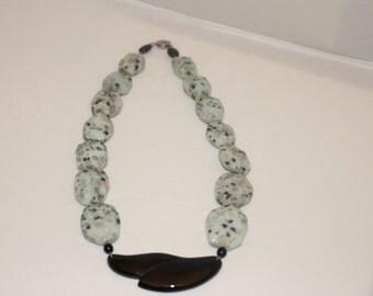 Dalmation Jasper beads with onyx pendant