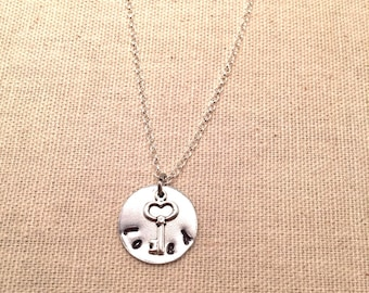 "Aluminum ""loved"" necklace with key"