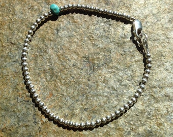 Sterling Silver beaded bracelet with Turquoise nugget.