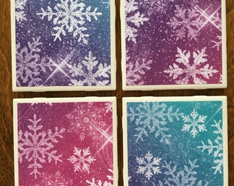 Set of four bright snowflake coasters