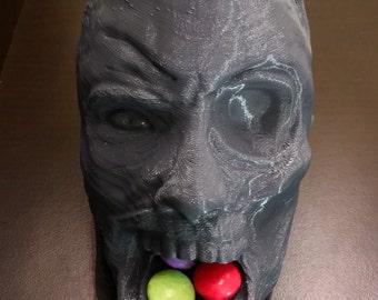 Zombie head dispenser for smarties