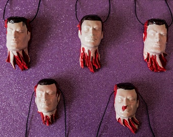 Beheaded Man Necklace