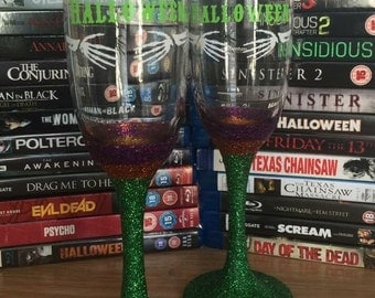 AllAboutEveGifts A pair of Handmade Happy Halloween Glitter Champagne Flutes
