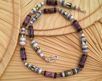 Peruvian Beads with Swarvoski Crystal beads create this 24 inch necklace finished off with a sterling Sliver clasp