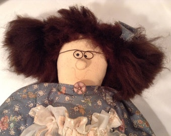 Vintage hand-sewn doll with blue dress