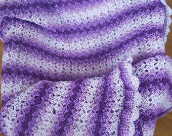 Shades of Purple baby blanket 32x47.  Zigzag stitch with shell border.