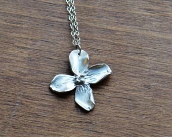 Handmade fine silver flower necklace.
