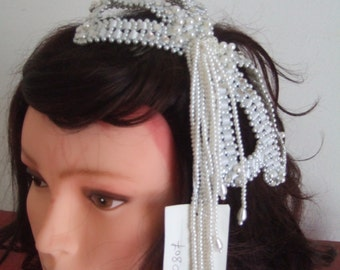 Wedding hairstyle with pearls and rhinestones wedding hairstyle pearls hair comb