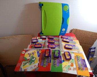 Leap Pad + 12 books, cartridges & Storage Binder
