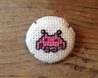 Space Invaders cross-stitch pins