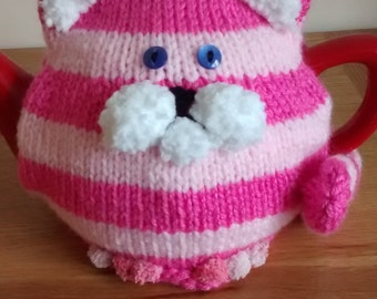 Hand-knitted Bagpuss tea cosy.