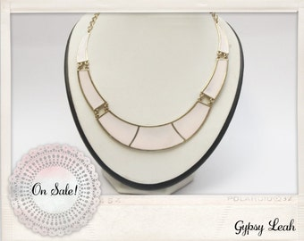 Pale pink statement collar necklace.