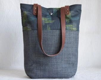 Shoulder bag with leather handles