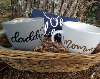 baby shower basket with mug and onesies