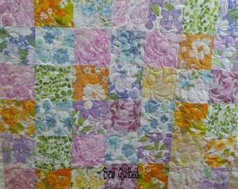 Gorgeous handmade vintage cot quilt. Made with 100% cotton, recycled vintage/retro fabrics. Professionally machine quilted floral design.