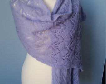 Knitted scarf with lace knitting pattern