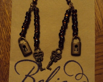 Brown and copper lock and key earrings.