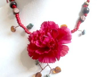 Red collar branch of beaded flowers.