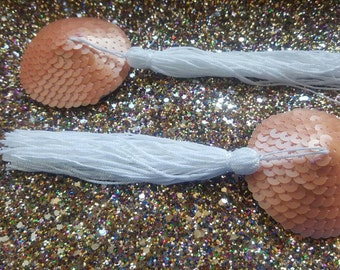 Peach, semi-matte sequin pasties with long white silky tassels
