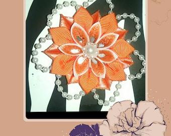 Orange and white kanzashi flower with pearl embellishments