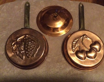 Pair of harvest themed copper molds