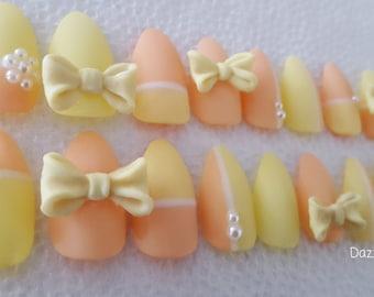 A set of 20 Almond shaped matte orange/yellow 3D bow gel nail/fake nails/faux nails/false nails/press on nails/glue on nails/nail design/