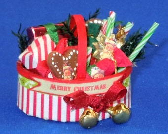 Dollhouse Miniature Christmas basket filled with goodies in twelfth scale, 1:12 scale.  Item #122