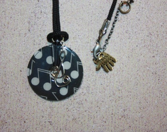 Necklace black and white music notes and key of g