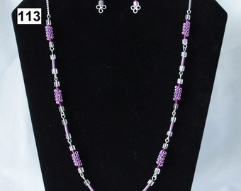 A Coiled Wire Necklace and Matching Earring Set in Violet and Red Wire-Work, Clear Beads and Silver Coloured Chain.