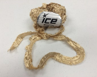 1 skein super bulky luxurious tan and gold feathered Ice brand yarn