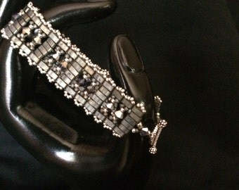 NO 49 Hand woven glass and crystal bracelet