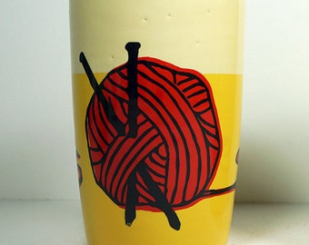 Slightly Unsightly - 18oz tumbler w/yarn ball print in red on colorblock of lemon butter & buttercream, ready to go.