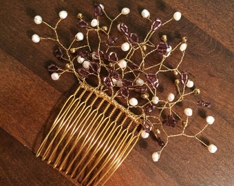 Fresh water pearl and purple crystal gold tone comb.
